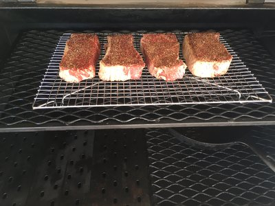 cheap steaks on for reverse sear.JPG
